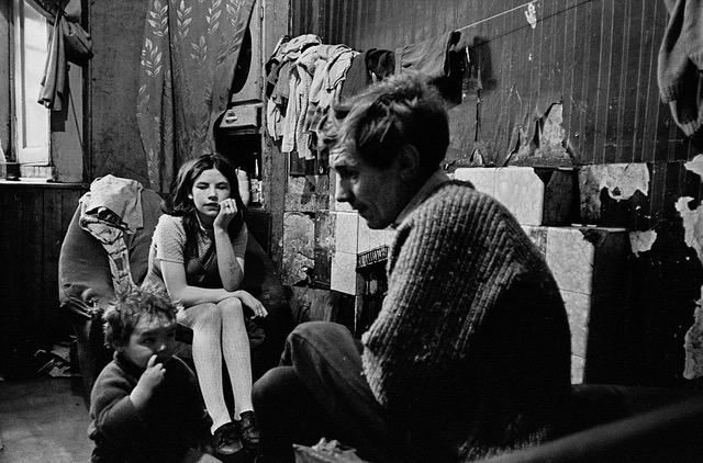 A life of despair: These images of Glasgow slums in the 60s and 70s include a father and his children sat silently in their Gorbals tenement flat in 1970. Above the fireplace, the wallpaper is peeling and clothing has been hung on a makeshift line to dry