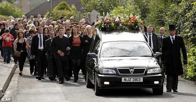 Final passage: Mourners join mother-of-five Mrs Graham on the last part of the journey before her burial