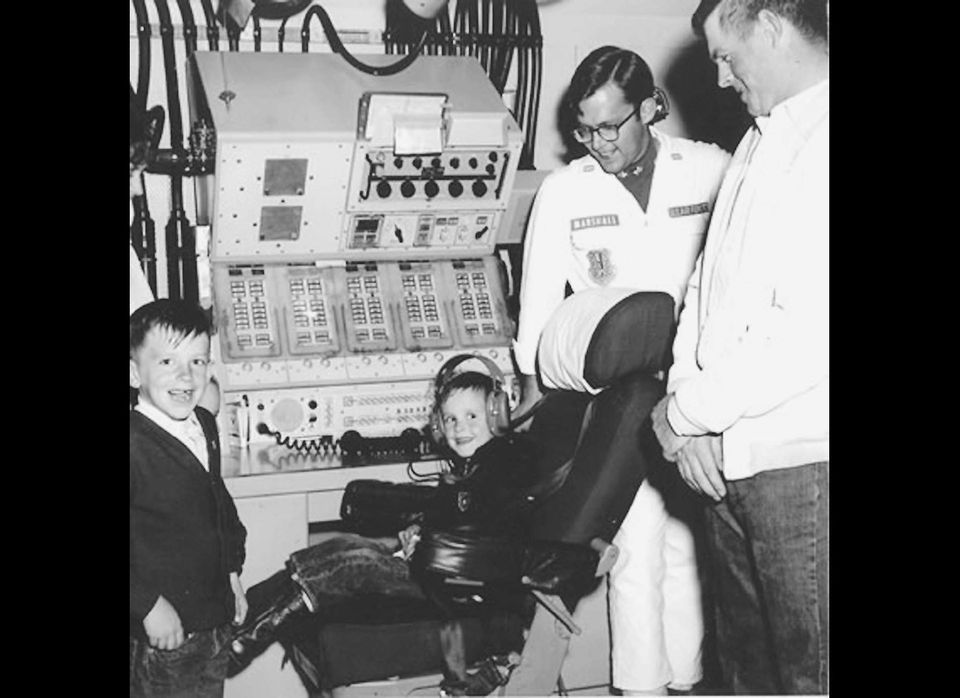 "Two boys at the controls of a Minuteman launch control center during a ""community day"" at a facility in South Dakota in the 1"