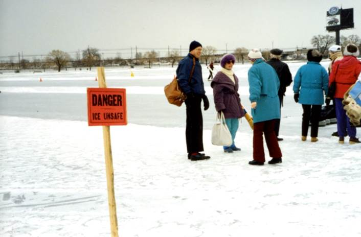 A group of people standing in the snow    Description automatically generated